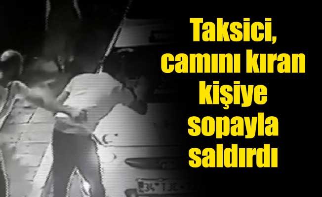 Taksici, camını kıran kişiye sopayla saldırdı